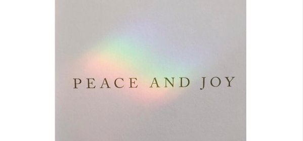 rainbow with printed words Peace and Joy.
